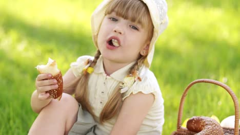 Girl-Eating-Bread-Nearby-Is-A-Basket-Of-Flowers