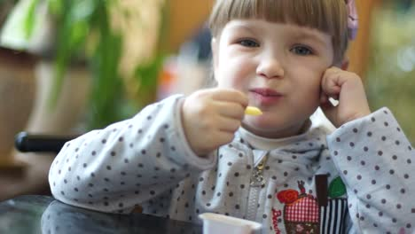 Girl-Eating-Fried-Potatoes