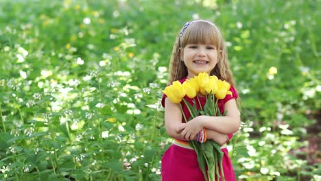 Girl-Turned-To-The-Camera-She-Is-Holding-A-Large-Bouquet-Of-Yellow-Tulips