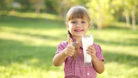 Happy-Girl-Drinking-Milk-Thumbs-Up-Ok