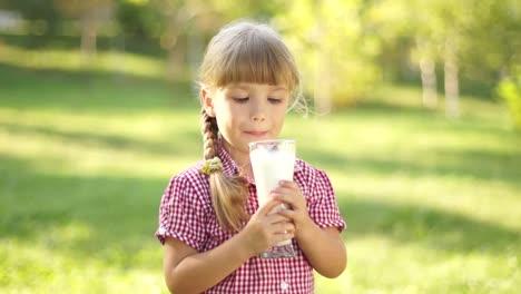 Happy-Little-Girl-Drinking-Milk-Thumbs-Up-Ok