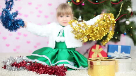 Laughing-Girl-Plays-With-Christmas-Decorations