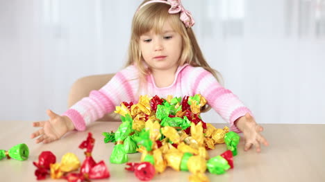 Little-Girl-Enjoys-Sweets