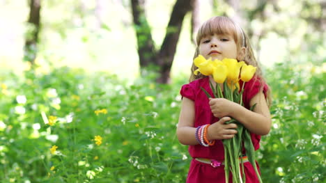 Little-Girl-Hugging-A-Bouquet-Of-Yellow-Tulips