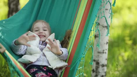 Little-Girl-Is-Resting-In-A-Hammock-In-The-Park-Near-The-House