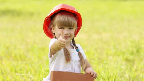 Little-Girl-With-The-Red-Brick-Building-She-In-Construction-Helmet