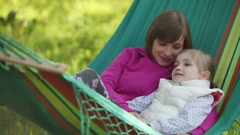 Mother-And-Daughter-Lying-In-A-Hammock-Mom-Tells-The-Tale