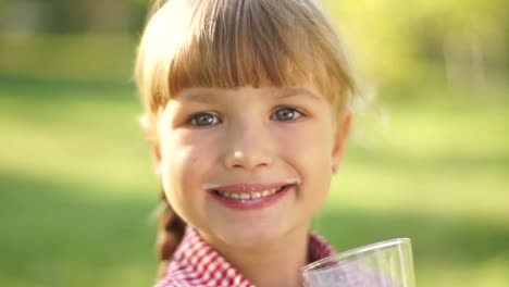 Portrait-Of-Smiling-Girl-Drinking-Milk-Milk-Moustache