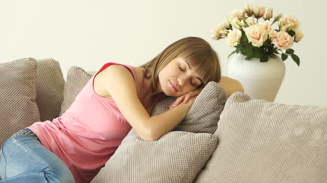Young-Woman-Sleeping-On-The-Couch