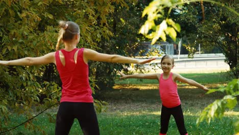 Athlete-Family-Mother-And-Daughter-Performing-A-Exercise-In-The-Park-19