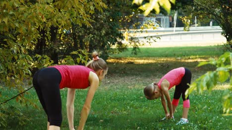 Athlete-Family-Mother-And-Daughter-Performing-A-Exercise-In-The-Park-20