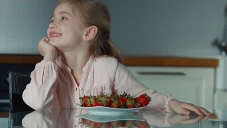 Beautiful-Child-Girl-And-A-Large-Plate-Of-Strawberries