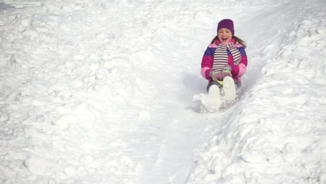 Beautiful-Woman-Riding-On-A-Sled-Down-The-Hills-Slow-Motion