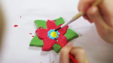 Girl-Drawing-Flower-Of-Gypsum