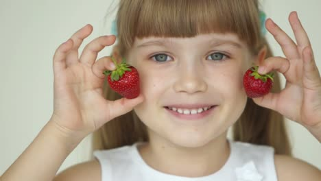 Girl-Hiding-Her-Eyes-With-Two-Strawberries