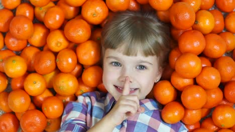 Hush-Hush-Happy-Child-In-Oranges-Looking-At-Camera