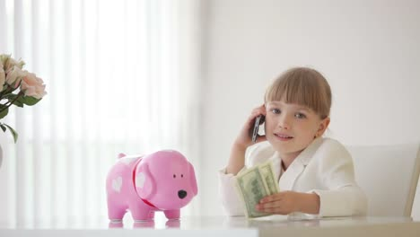 Little-Businesswoman-Sitting-At-A-Desk-And-Talking-On-The-Phone