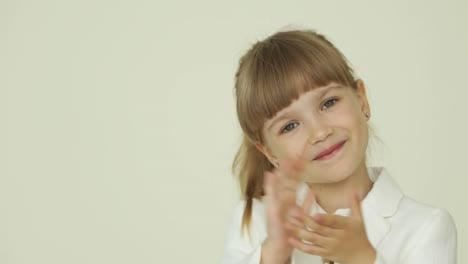 Little-Girl-Clapping-Her-Hands-And-Nods