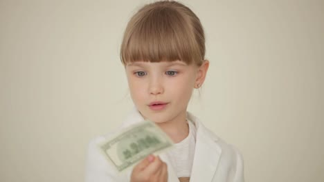 Little-Girl-Holding-A-Money-Bill