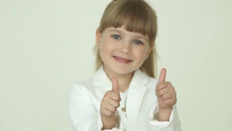 Little-Girl-With-Ok-Hands-Sign-Nods