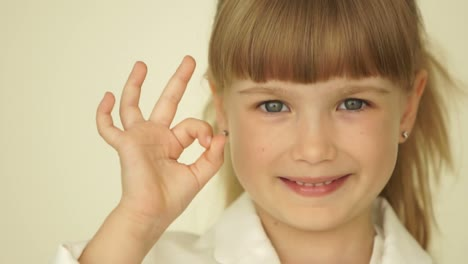 Little-Girl-With-Ok-Hands-Sign-Slowmotion