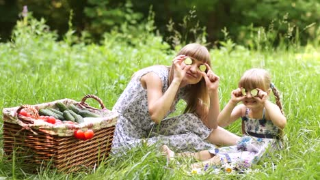 Mother-And-Daughter-With-Vegetables-Outdoors