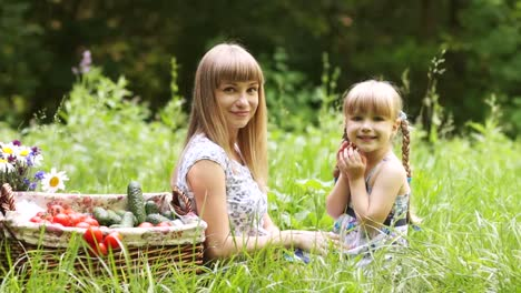 Mother-Gives-Baby-Vegetables-They-Are-Outdoors