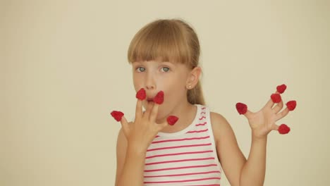 Pretty-Little-Girl-Eating-Raspberries-From-Top-Of-Her-Fingers