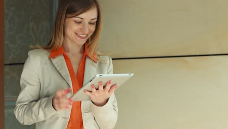 Businesswoman-Showing-Her-Success-On-The-Tablet-PC