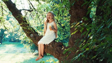Child-6-8-Years-Playing-And-Blowing-Soap-Bubbles-On-A-Tree