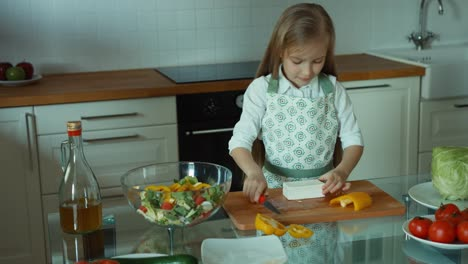 Child-cuts-feta-cheese-and-smiles