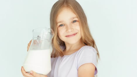 Child-Drinking-Milk-From-Jug-On-A-White-Background-Thumb-Up-Ok-Closeup
