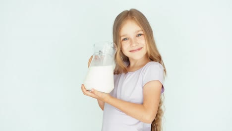 Child-Drinking-Milk-From-Jug-On-A-White-Background-Thumb-Up-Ok