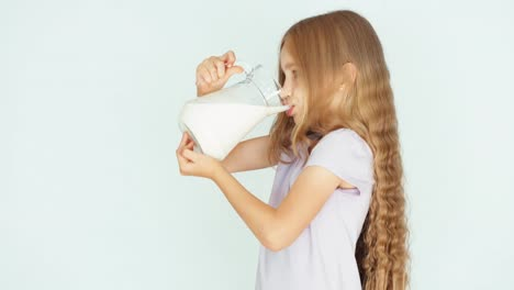 Child-Drinking-Milk-From-Jug-Girl-With-Beautiful-Blond-Hair