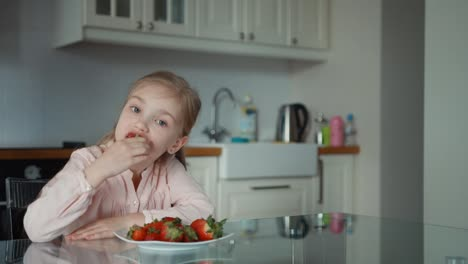 Child-Eating-A-Big-Red-Strawberry-Panning