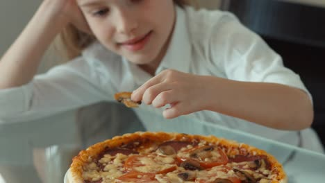 Child-Eating-A-Mushroom-From-Pizza-Smiling-At-Camera-And-Laughing