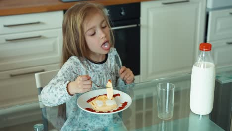Child-Eating-Eggs-And-Looking-At-The-Camera
