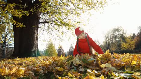 Child-Girl-7-Years-Old-Collects-A-Bouquet-Of-Autumn-Leaves-In-The-Park-And-Sm