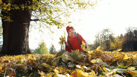 Niño-Girl-8-Years-Old-Collects-A-Bouquet-Of-Autumn-Leaves-In-The-Park-And-Sm
