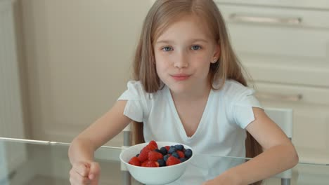 Child-Girl-Eating-Fruit-Salad-And-Smiling-At-Camera-Thumb-Up-Ok