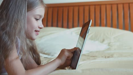 Child-Girl-Using-Tablet-PC