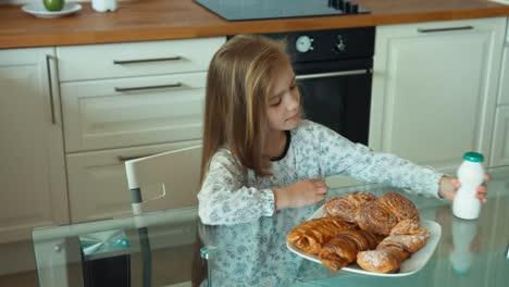 Child-Has-Breakfast-The-Girl-Opens-A-Bottle-Of-Yogurt