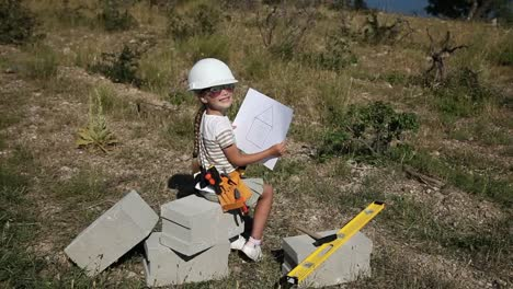 Child-Is-Little-Builder-Girl-In-The-Construction-Helmet-And-With-Sunglasses