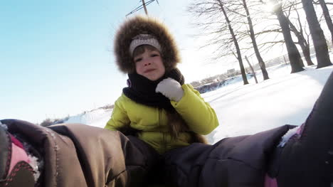 Child-Is-Riding-On-A-Sledge