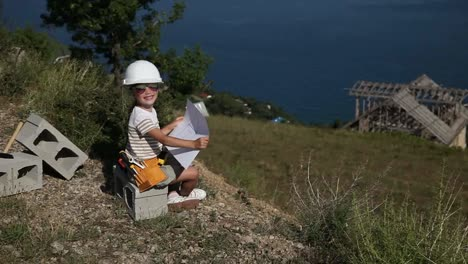 Child-Is-The-Builder-Girl-In-The-Construction-Helmet-And-With-Sunglasses