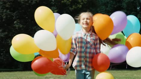 Child-Jumping-With-Balloons-In-The-Park