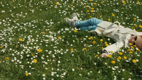 Child-Lying-On-The-Grass-And-Flowers