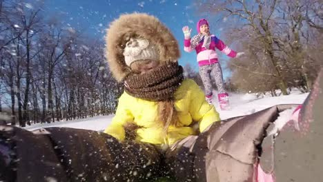 Child-Riding-On-A-Sledge-Mother-Running-After-Her-Daughter