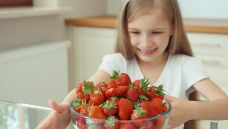 Child-Rubs-Her-Hands-Girl-With-A-Large-Plate-Of-Strawberries
