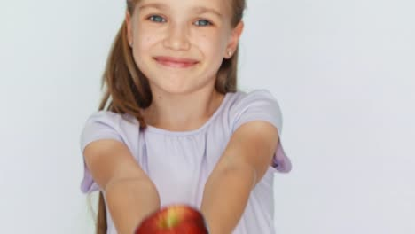 Child-Showing-Red-Apple-Girl-Holding-A-Red-Apple-In-The-Palm-Closeup